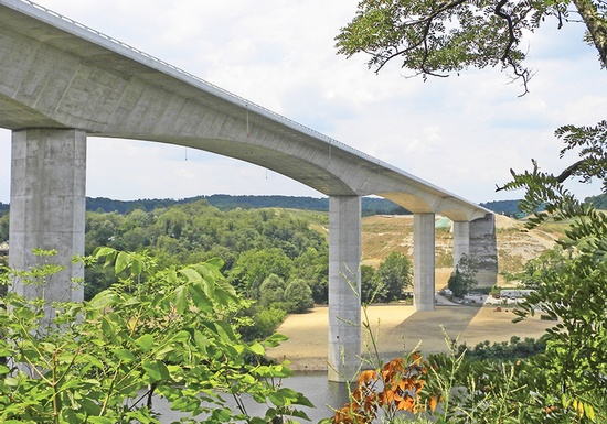 Figure 1 – Monongahela River Bridge – Pennsylvania's newest concrete segmental bridge provides an important link in the Pennsylvania Turnpike Commission's transportation system. The bridge's long open spans create an economical and aesthetically pleasing bridge high above the river valley. (Photo Courtesy of FIGG).