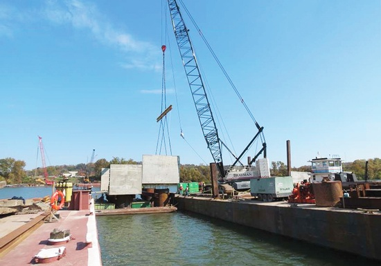 Figure 4 – Lowering Pier 3 Right Downstation Precast Segment. (Photo Courtesy of Finley Engineering Group, Inc.)