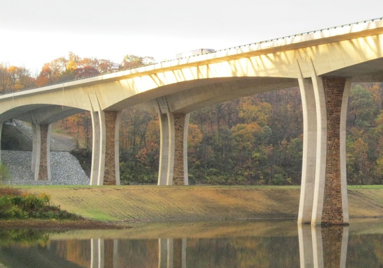 Figure 13 - October 2010 – The new I-76 Allegheny River Bridge is open to traffic. This segmental bridge features curved piers and a stone texture to complement the surrounding landscape. (Photo Courtesy of FIGG).