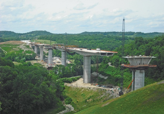 Figure 12 – Monongahela River Bridge, Brownsville, Pennsylvania – Cantilever construction of this concrete segmental bridge is nearing completion, with only two cantilevers left to be built. (Photo Courtesy of FIGG, taken June 2011)