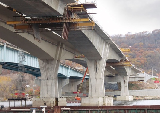 All cantilever construction is complete and traveler removal operations occur at Cantilevers 1 and 2 WB. (Photo Courtesy of FIGG).