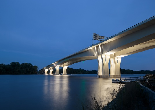 The New Dresbach Bridge's dual 508-foot main spans gracefully cross the Mississippi River.  Photo courtesy of FIGG.